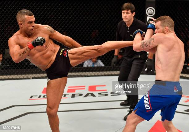Vitor Belfort of Brazil kicks Nate Marquardt in their middleweight bout during the UFC 212 event at Jeunesse Arena on June 3 2017 in Rio de Janeiro...