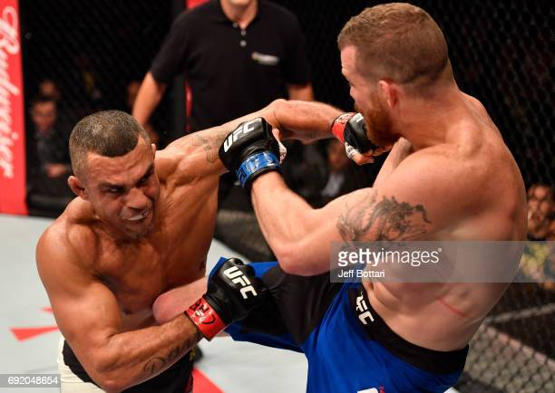 Vitor Belfort of Brazil punches Nate Marquardt in their middleweight bout during the UFC 212 event at Jeunesse Arena on June 3 2017 in Rio de Janeiro...