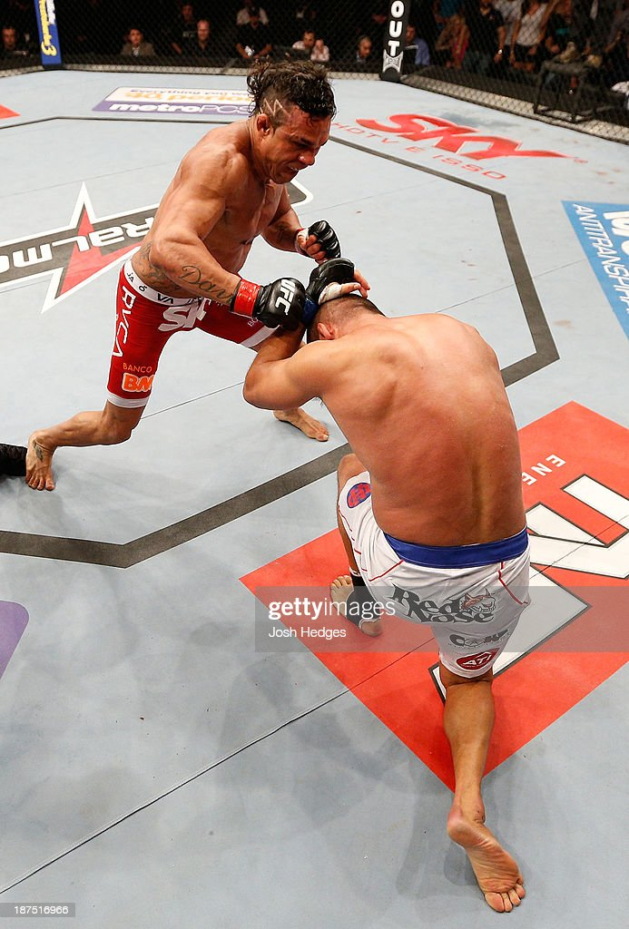<a gi-track='captionPersonalityLinkClicked' href=/galleries/search?phrase=Vitor+Belfort&family=editorial&specificpeople=3433934 ng-click='$event.stopPropagation()'>Vitor Belfort</a> punches Dan Henderson in their light heavyweight bout during the UFC event at Arena Goiania on November 9, 2013 in Goiania, Brazil.