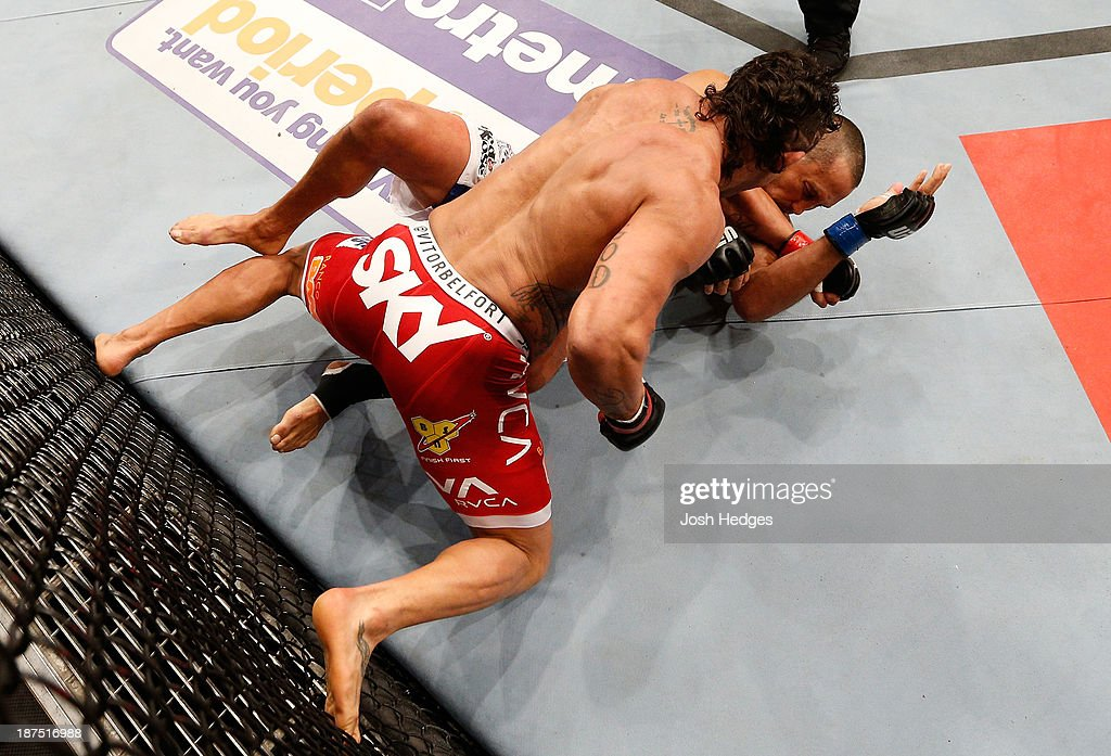 Vitor Belfort punches Dan Henderson in their light heavyweight bout during the UFC event at Arena Goiania on November 9, 2013 in Goiania, Brazil.