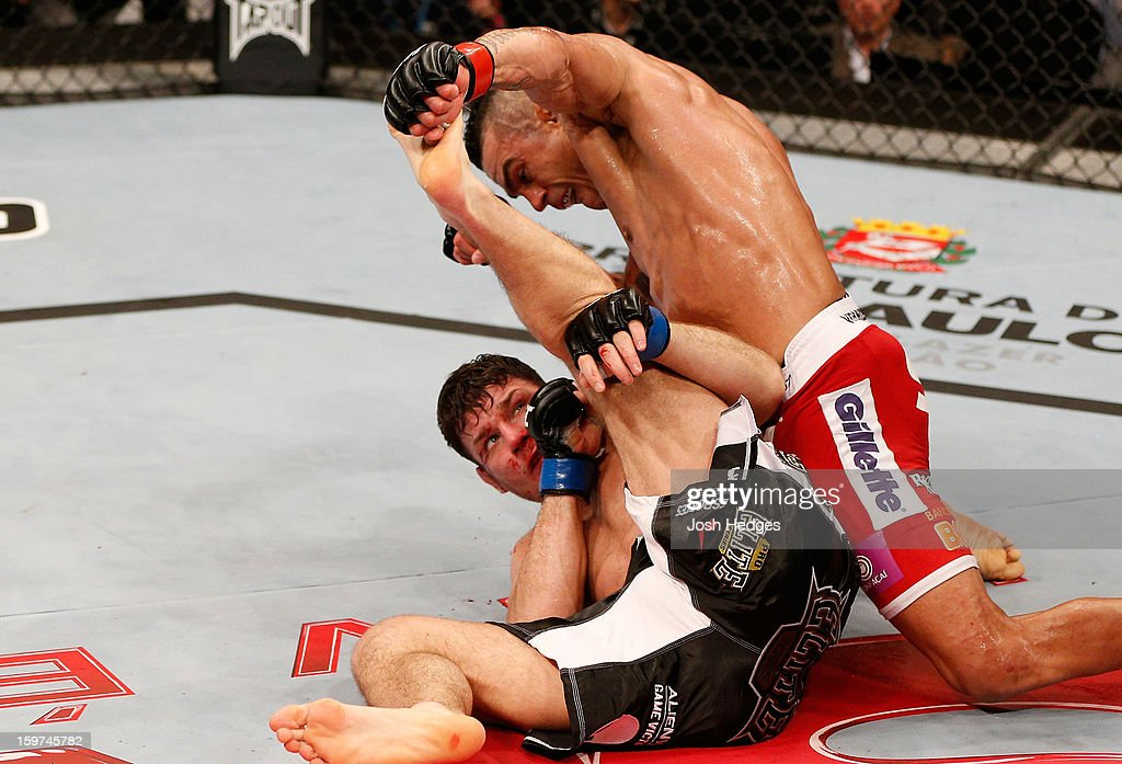 Vitor Belfort (top) punches down at Michael Bisping in their middleweight fight at the UFC on FX event on January 19, 2013 at Ibirapuera Gymnasium in Sao Paulo, Brazil.