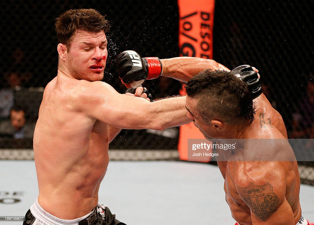 Vitor Belfort punches Michael Bisping in their middleweight fight at the UFC on FX event on January 19, 2013 at Ibirapuera Gymnasium in Sao Paulo, Brazil.
