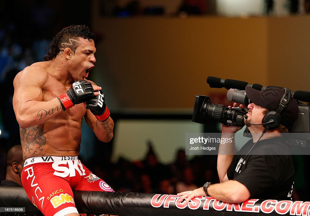 <a gi-track='captionPersonalityLinkClicked' href=/galleries/search?phrase=Vitor+Belfort&family=editorial&specificpeople=3433934 ng-click='$event.stopPropagation()'>Vitor Belfort</a> reacts after knocking out Dan Henderson in their light heavyweight bout during the UFC event at Arena Goiania on November 9, 2013 in Goiania, Brazil.