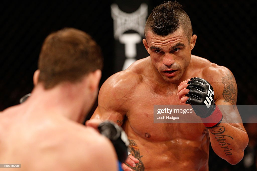 Vitor Belfort squares off with <a gi-track='captionPersonalityLinkClicked' href=/galleries/search?phrase=Michael+Bisping&family=editorial&specificpeople=4165714 ng-click='$event.stopPropagation()'>Michael Bisping</a> in their middleweight fight at the UFC on FX event on January 19, 2013 at Ibirapuera Gymnasium in Sao Paulo, Brazil.