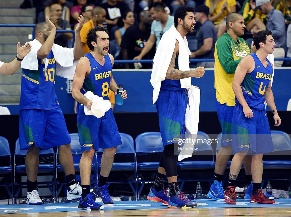 Vitor Benite #8, Augusto Lima #6 and Ricardo Fischer #4 of Brazil celebrate during a 93-83 win over the United States of America in the men's basketball preliminary round during the 2015 Pan Am Games at the Ryerson Athletic Centre on July 23, 2015 in Toronto, Canada.