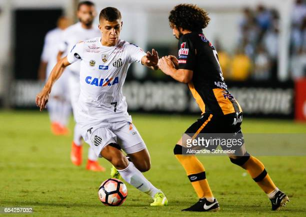 Vitor Bueno of Santos and Luis Fernando Martelli of The Strongest in action during the match between Santos of Brazil and The Strongest of Bolivia...