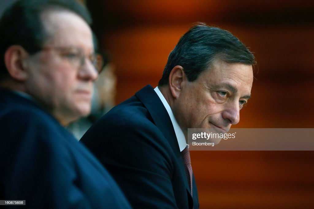 Vitor Constancio, vice president of the European Central Bank, left, and Mario Draghi, president of the European Central Bank (ECB), attend a news conference at the bank's headquarters in Frankfurt, Germany, on Thursday, Feb.7, 2013. The European Central Bank left interest rates unchanged even as a stronger currency threatens the euro area's recovery from recession. Photographer: Ralph Orlowski/Bloomberg via Getty Images