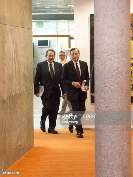 Vitor Constancio vice president of the European Central Bank left and Mario Draghi president of the European Central Bank walk through a corridor as...