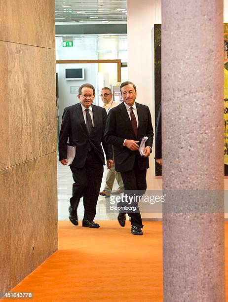 Vitor Constancio vice president of the European Central Bank left and Mario Draghi president of the European Central Bank walk through a corridor as...