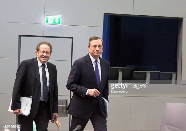 Vitor Constancio vice president of the European Central Bank left and Mario Draghi president of the European Central Bank arrive for a news...