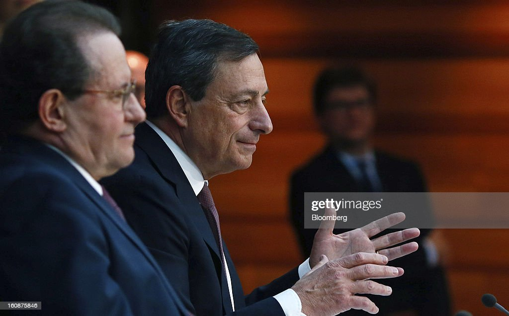 Vitor Constancio, vice president of the European Central Bank, left, listens as Mario Draghi, president of the European Central Bank (ECB), center, speaks during a news conference at the bank's headquarters in Frankfurt, Germany, on Thursday, Feb.7, 2013. The European Central Bank left interest rates unchanged even as a stronger currency threatens the euro area's recovery from recession. Photographer: Ralph Orlowski/Bloomberg via Getty Images