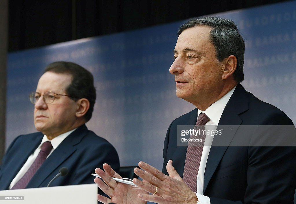 Vitor Constancio, vice president of the European Central Bank, left, listens as Mario Draghi, president of the European Central Bank (ECB), speaks during a news conference at the bank's headquarters in Frankfurt, Germany, on Thursday, Feb.7, 2013. The European Central Bank left interest rates unchanged even as a stronger currency threatens the euro area's recovery from recession. Photographer: Ralph Orlowski/Bloomberg via Getty Images