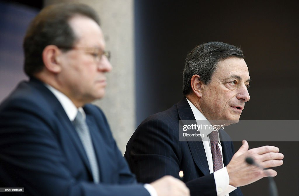 Vitor Constancio, vice president of the European Central Bank, left, listens as Mario Draghi, president of the European Central Bank (ECB), speaks during a news conference at the bank's headquarters in Frankfurt, Germany, on Thursday, March 7, 2013. Draghi stuck to his view that the euro-area economy will gradually recover later this year as policy makers trimmed their economic and inflation forecasts. Photographer: Ralph Orlowski/Bloomberg via Getty Images