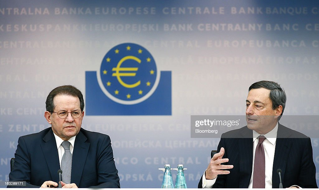 Vitor Constancio, vice president of the European Central Bank (ECB), left, listens as Mario Draghi, president of the European Central Bank (ECB), speaks during a news conference at the bank's headquarters in Frankfurt, Germany, on Thursday, March 7, 2013. Draghi stuck to his view that the euro-area economy will gradually recover later this year as policy makers trimmed their economic and inflation forecasts. Photographer: Ralph Orlowski/Bloomberg via Getty Images