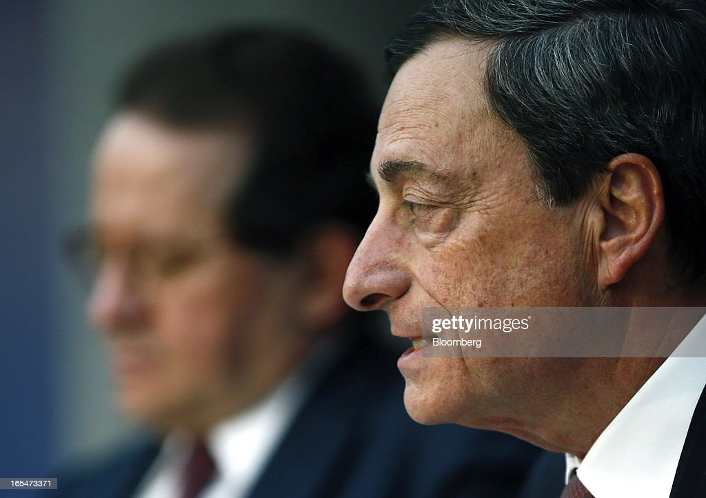 Vitor Constancio, vice president of the European Central Bank (ECB), left, listens as Mario Draghi, president of the European Central Bank (ECB), speaks during a news conference at the bank's headquarters in Frankfurt, Germany, on Thursday, April 4, 2013. Draghi signaled the ECB stands ready to cut interest rates if the economy deteriorates and said officials are considering additional measures as a debt crisis enters its fourth year. Photographer: Ralph Orlowski/Bloomberg via Getty Images