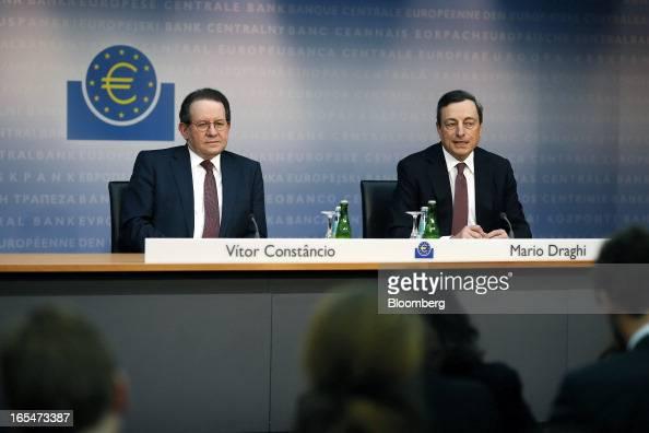 Vitor Constancio vice president of the European Central Bank left listens as Mario Draghi president of the European Central Bank speaks during a news...