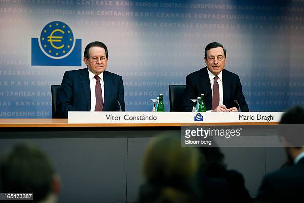 Vitor Constancio vice president of the European Central Bank left listens as Mario Draghi president of the European Central Bank speaks during a news...