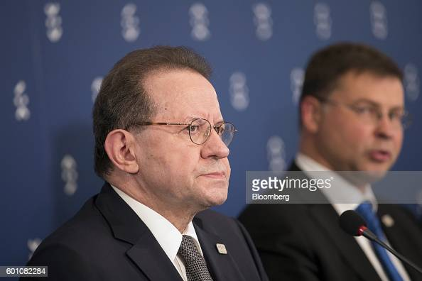 Vitor Constancio vice president of the European Central Bank left listens as Valdis Dombrovskis vice president of the European Commission speaks...