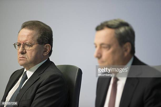 Vitor Constancio vice president of the European Central Bank left looks on during a news conference with Mario Draghi president of the European...