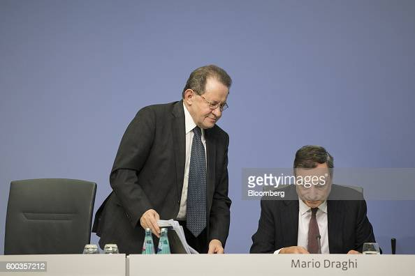 Vitor Constancio vice president of the European Central Bank left stands beside Mario Draghi president of the European Central Bank at the end of a...