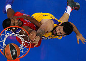 Vitor Faverani #13 of Maccabi Fox Tel Aviv competes with Kyle Hines #42 of CSKA Moscow during the Turkish Airlines Euroleague Basketball Regular...