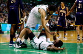 Vitor Faverani helps up Jordan Crawford of the Boston Celtics during a game against the Indiana Pacers at the TD Garden on November 22 2013 in Boston...