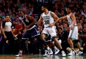 Vitor Faverani of the Boston Celtics defends against Serge Ibaka of the Oklahoma City Thunder during a game at the TD Garden on January 24 2014 in...