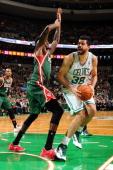 Vitor Faverani of the Boston Celtics drives to the basket against the Milwaukee Bucks on November 1 2013 at the TD Garden in Boston Massachusetts...