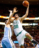 Vitor Faverani of the Boston Celtics goes up for a layup in front Timofey Mozgov of the Denver Nuggets in the second quarter during the game at TD...