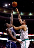 Vitor Faverani of the Boston Celtics goes up for a shot against Kendrick Perkins of the Oklahoma City Thunder during a game at the TD Garden on...