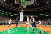 Vitor Faverani of the Boston Celtics grabs a rebound against the Charlotte Bobcats on November 13 2013 at the TD Garden in Boston Massachusetts NOTE...