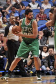 Vitor Faverani of the Boston Celtics looks to pass against the Orlando Magic during the game on November 8 2013 at Amway Center in Orlando Florida...