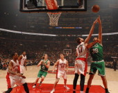 Vitor Faverani of the Boston Celtics puts up a shot against the Toronto Raptors on October 23 2013 at the Air Canada Centre in Toronto Ontario Canada...