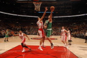 Vitor Faverani of the Boston Celtics shoots against Landry Fields of the Toronto Raptors during the game on October 16 2013 at the Air Canada Centre...