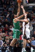 Vitor Faverani of the Boston Celtics shoots against Zaza Pachulia of the Milwaukee Bucks on November 30 2013 at the BMO Harris Bradley Center in...