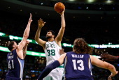 Vitor Faverani of the Boston Celtics shoots over Kosta Koufos of the Memphis Grizzlies in the first quarter during the game at TD Garden on November...