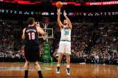 Vitor Faverani of the Boston Celtics shoots the ball against Joel Freeland of the Portland Trailblazers on November 15 2013 at the TD Garden in...