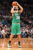 Vitor Faverani of the Boston Celtics shoots the ball against the Minnesota Timberwolves on November 16 2013 at Target Center in Minneapolis Minnesota...