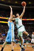 Vitor Faverani of the Boston Celtics shoots the ball against the Denver Nuggets on December 6 2013 at the TD Garden in Boston Massachusetts NOTE TO...