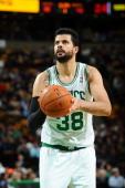 Vitor Faverani of the Boston Celtics shoots the foul shot against the Charlotte Bobcats on November 13 2013 at the TD Garden in Boston Massachusetts...