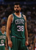 Vitor Faverani of the Boston Celtics stands on the court against the Toronto Raptors during their NBA game at the Air Canada Centre on October 30...