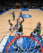 Vitor Faverani of the Boston Celtics takes a shot over Kevin Love of the Minnesota Timberwolves as both Kelly Olynyk of the Boston Celtics and Ronny...