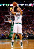 Vitor Faverani of the Boston Celtics takes a threepoint shot in the second quarter against the Portland Trailblazers during the game at TD Garden on...