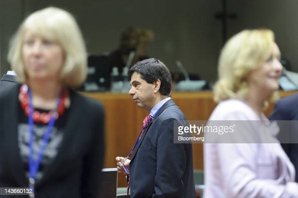 Vitor Gaspar Portugal's finance minister center arrives ahead of a meeting of European Union finance ministers at the European Council headquarters...