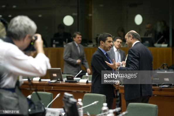 Vitor Gaspar Portugal's finance minister center speaks with Luis de Guindos Spain's economy minister right ahead of a European Union finance...
