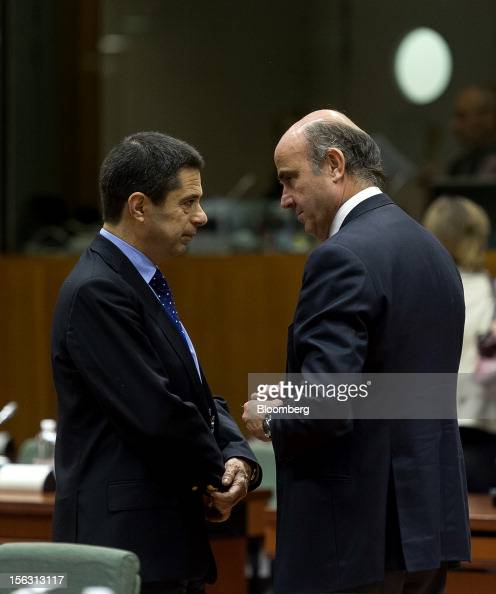 Vitor Gaspar Portugal's finance minister left speaks with Luis de Guindos Spain's economy minister ahead of a European Union finance ministers...