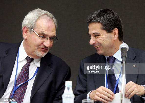 Vitor Gaspar Portugal's finance minister right speaks with Philippe Le Houerou vice president of The World Bank Group's Europe and Central Asia...
