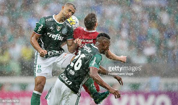 Vitor Hugo and Yerry Mina of Palmeiras fights for the ball with Aylon of Internacional during the match between Palmeiras and Internacional for the...