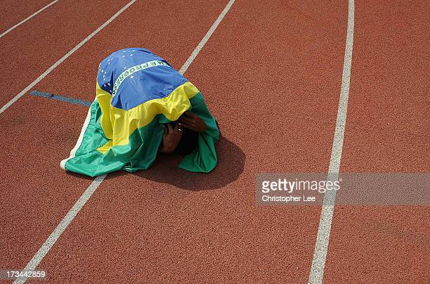 Vitor Hugo Dos Santos of Brazil covers himself in a Brazil flag after he wins the silver medal in the Boys 200m Final during Day 5 of the IAAF World...
