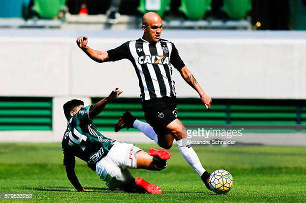 Vitor Hugo of Palmeiras and Fabio Santos of Atletico MG in action during the match between Palmeiras and Atletico MG for the Brazilian Series A 2016...